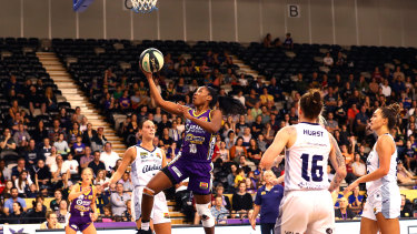 Off to a flyer: Lindsay Allen drives to the basket for the Boomers during the round 10 WNBL match against Adelaide Lightning at the State Basketball Centre in Melbourne.