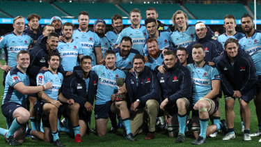 The Waratahs pose for a photo after their emphatic win over the Queensland Reds on Saturday.