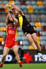 Tom Lynch pulls down a strong mark against his former team.