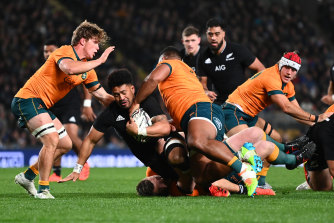 New All Blacks skipper Ardie Savea is tackled in the first Test.