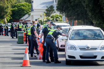 Police stop motorists travelling from NSW at a checkpoint in Wodonga on the Victorian side of the border with NSW.