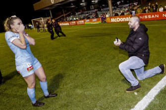 Matt Stonham proposes to Melbourne City's Rhali Dobson after her W-League game against Perth.