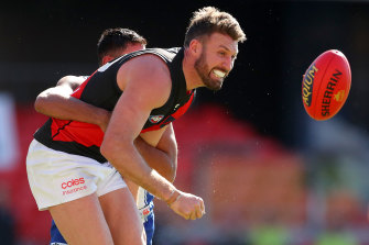 Essendon's Cale Hooker will miss the clash with Sydney this weekend.
