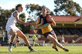 The Bendigo Pioneers' Harley Reid runs with the ball during the clash with the Geelong Falcons.