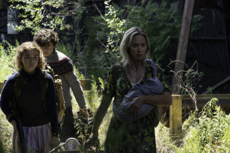 Regan (Millicent Simmonds), Marcus (Noah Jupe) and Evelyn (Emily Blunt) brave the unknown in A Quiet Place Part II.