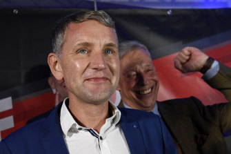 Bjoern Hoecke, chairman of the far-right Alternative fuer Deutschland (AfD) in Thuringia celebrates with supporters.