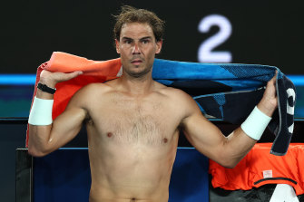 Rafael Nadal towels down after winning the first set against Michael Mmoh.