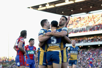 The Eels celebrate Haze Dunster's try during the big win over Newcastle.