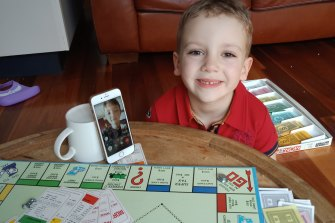 Five-year-old Charlie plays Monopoly with his cousin.