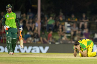 Australia's bowler Pat Cummins, right, reacts after dropping a catch off South Africa's batsman Heinrich Klaasen during the second One Day International.