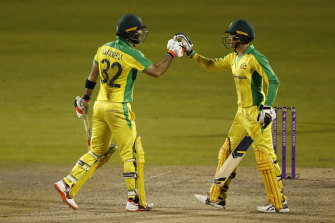 Australia's Glenn Maxwell (left) celebrates with Alex Carey. Both players scored centuries.