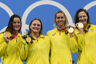 Australia's women's 4x100m medley relay team, Kaylee Mckeown, Chelsea Hodges, Emma Mckeon and Cate Campbell pose after winning the gold medal in Tokyo.