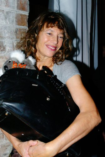 Jane Birkin in Sydney in 2005 with her famous bag, which she always treated like a workhorse, never an ornament.