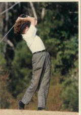 Ginny Bevan teeing off with a powerful swing.