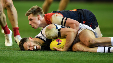 Charlie Spargo. tackles Sam Menegola in last week's elimination final at the MCG.