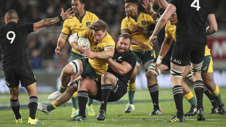 No quarter given: Joe Moody drags Wallabies skipper Michael Hooper to ground.