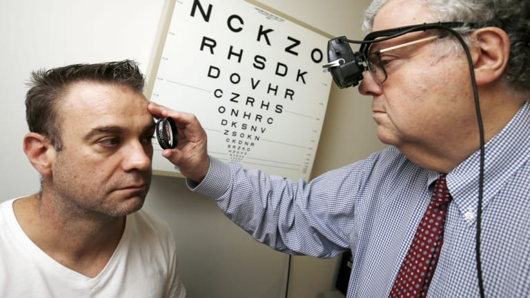 Dave Ames has his eyes inspected by Professor Owen White.