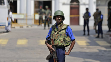 Sri Lankan navy soldiers keep guard outside St Anthony's Church in Colombo on Thursday as authorities warn of further 'imminent' attacks.