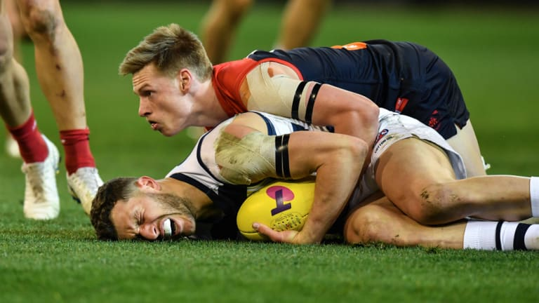 Sam Menegola is tackled by Charlie Spargo.
