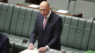 Home Affairs Minister Peter Dutton speaking in the House of Representatives, denying any personal connection to a series of interventions in visa cases.