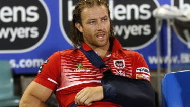 Big loss: Korbin Sims (broken arm) joins Dragons captain Gareth Widdop on the sidelines.