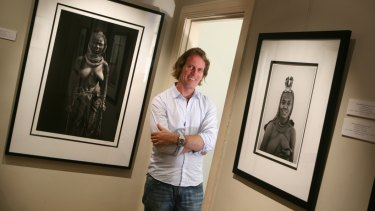 Photographer Christopher Rimmer, who often represents African themes, with some of his art works.