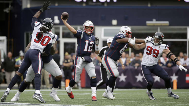 New England Patriots quarterback Tom Brady throws under pressure against the Texans.