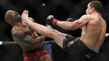 Robert Whittaker (right) lands a blow in his 2018 bout with Yoel Romero (left).