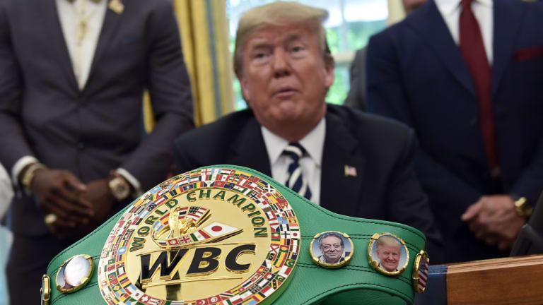 A boxing belt presented to Donald Trump sits on the desk in Oval Office as he pardons Jack Johnson.