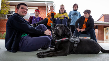 Carenne School's winning team, from left: William Tatnell, 17, Connor Drewe, 16, Kade Muldoon, 12, school captain Mitchell Allan, 18, Callan Derwnt, 13, and Keith Pracy, 15, and therapy dog Ollie.