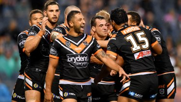 Vintage display: Benji Marshall and the Tigers celebrate a try.