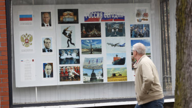 A man walks past the Russian embassy in Prague, Czech Republic. The country is expelling three staffers from the embassy.
