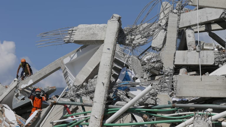 Indonesian rescuers search for people in the ruins of Roa-Roa Hotel in Palu on  Monday.