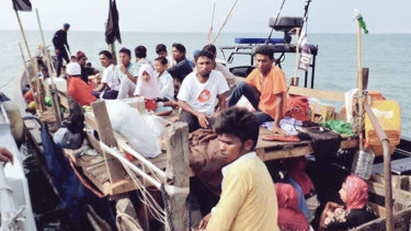 Malaysian navy officers detaining a boat carrying Rohingya migrants earlier this month.