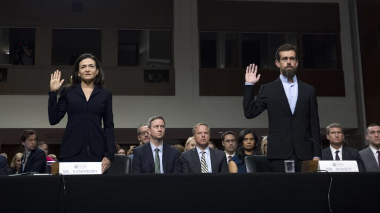 Facebook COO Sheryl Sandberg, left, accompanied by Twitter CEO Jack Dorsey at a Senate hearing