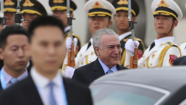 Brazilian President Michel Temer is treated to a guard of honour in Beijing last year.