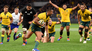 Absolute menace: Kurtley Beale crosses for the Wallabies from fullback, a position he has now made his own.