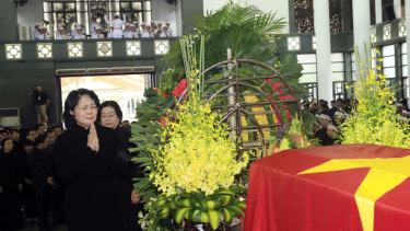 Vietnamese acting President Dang Thi Ngoc Thinh prays before the coffin of late Vietnamese President Tran Dai Quang in Hanoi, Vietnam.