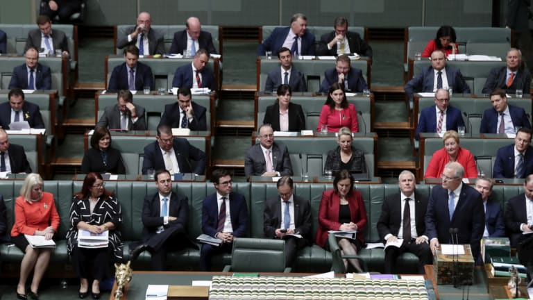 Female Liberal MPs wear red in a show of solidarity in the House of Representatives on Monday.