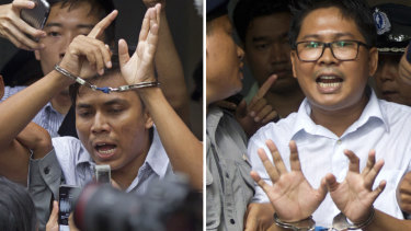 Reuters journalists Kyaw Soe Oo, left, and  Wa Lone, are handcuffed as they are escorted by police out of the court on Monday.