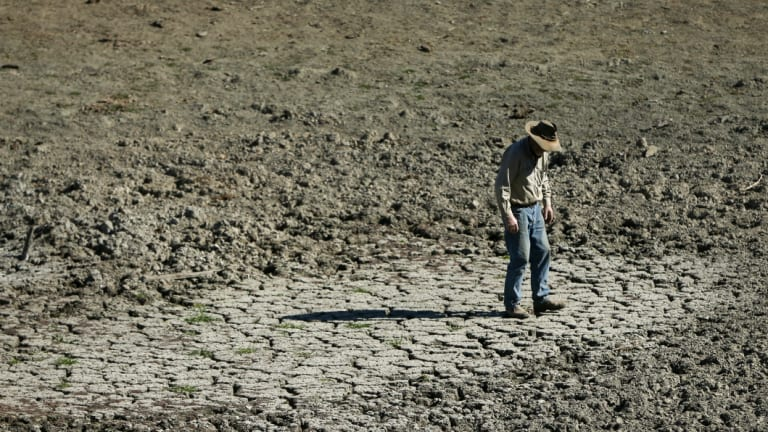 Bill Hannah in one of the four empty dams on his property in Gundy, in the Hunter region of NSW. Much of Australia is - yet again - in the grip of drought.