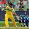 Shaun Marsh plays and misses during the Third One-Day International match between Australia and India at the MCG .