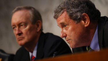 Senator Sherrod Brown of the Senate Banking Committee, right, and Senator Mike Crapo, chairman of the Senate Banking Committee, listen during a hearing about Facebook's cryptocurrency plan.