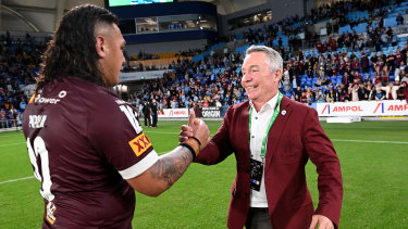 Maroons coach Paul Green celebrates the 20-18 win over NSW with Josh Papalii.