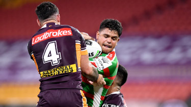 Latrell Mitchell takes on Brisbane's defence in their NRL round two clash at Suncorp Stadium.