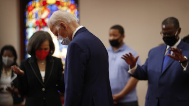 Democratic presidential candidate, former vice-president Joe Biden bows his head in prayer during a visit to Bethel AME Church in Delaware.