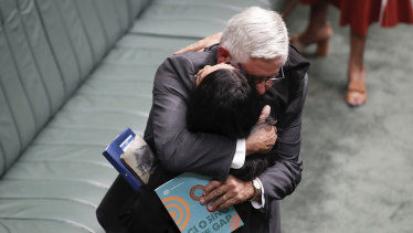 Minister for Indigenous Australians Ken Wyatt embraces Labor counterpart Linda Burney.