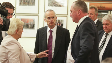 ACCC chair Rod Sims speaks with Barnaby Joyce before addressing the Nationals party room meeting on Monday.