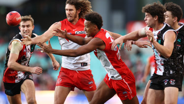 Joel Amartey and Tom Hickey vie for the ball against St Kilda