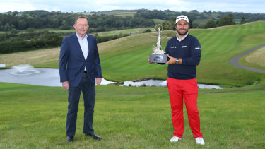 Former Australian PM Tony Abbott pictured a few days ago with French golfer Romain Langasque at the Wales Open.